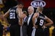 May 16, 2013; Oakland, CA, USA; San Antonio Spurs head coach Gregg Popovich (center) instructs power forward Tim Duncan (21) and point guard Tony Parker (9) during the third quarter in game six of the second round of the 2013 NBA Playoffs against the Golden State Warriors at Oracle Arena. The Spurs defeated the Warriors 94-82.  Mandatory Credit: Kyle Terada-USA TODAY Sports