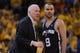 May 16, 2013; Oakland, CA, USA; San Antonio Spurs head coach Gregg Popovich (left) instructs point guard Tony Parker (9) during the third quarter in game six of the second round of the 2013 NBA Playoffs against the Golden State Warriors at Oracle Arena. The Spurs defeated the Warriors 94-82.  Mandatory Credit: Kyle Terada-USA TODAY Sports