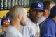 Jun 16, 2013; Pittsburgh, PA, USA; Los Angeles Dodgers right fielder Yasiel Puig (right) talks to second baseman Skip Schumaker (left) in the dugout against the Pittsburgh Pirates during the fifth inning at PNC Park. Mandatory Credit: Charles LeClaire-USA TODAY Sports
