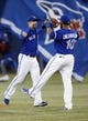 Jun 22, 2013; Toronto, Ontario, CAN; Toronto Blue Jays right fielder Jose Bautista (19) and first baseman Edwin Encarnacion (10) celebrate a win over the Baltimore Orioles at the Rogers Centre. Toronto defeated Baltimore 4-2. Mandatory Credit: John E. Sokolowski-USA TODAY Sports