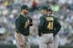 Jun 22, 2013; Seattle, WA, USA; Oakland Athletics pitcher Dan Straily (67) has a discussion with pitching coach Curt Young (41) during the second inning against the Seattle Mariners at Safeco Field. Mandatory Credit: Joe Nicholson-USA TODAY Sports