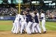 Jun 23, 2013; Seattle, WA, USA; Seattle Mariners designated hitter Kendrys Morales (8) is mobbed by his teammates after hitting the game winning 3-run home run against the Oakland Athletics during the 10th inning at Safeco Field. Seattle defeated Oakland 6-3. Mandatory Credit: Steven Bisig-USA TODAY Sports