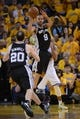 May 12, 2013; Oakland, CA, USA; San Antonio Spurs point guard Tony Parker (9) passes the ball to shooting guard Manu Ginobili (20) during the third quarter in game four of the second round of the 2013 NBA Playoffs against the Golden State Warriors at Oracle Arena. The Warriors defeated the Spurs 97-87 in overtime. Mandatory Credit: Kyle Terada-USA TODAY Sports
