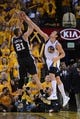May 12, 2013; Oakland, CA, USA; Golden State Warriors center Andrew Bogut (12) blocks the shot of San Antonio Spurs power forward Tim Duncan (21) during the fourth quarter in game four of the second round of the 2013 NBA Playoffs at Oracle Arena. The Warriors defeated the Spurs 97-87 in overtime. Mandatory Credit: Kyle Terada-USA TODAY Sports