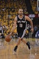 May 10, 2013; Oakland, CA, USA; San Antonio Spurs point guard Tony Parker (9) dribbles the ball during the first quarter in game three of the second round of the 2013 NBA Playoffs against the Golden State Warriors at Oracle Arena. The Spurs defeated the Warriors 102-92. Mandatory Credit: Kyle Terada-USA TODAY Sports