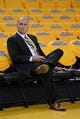 May 10, 2013; Oakland, CA, USA; Golden State Warriors assistant general manager Travis Schlenk watches warm ups before game three of the second round of the 2013 NBA Playoffs against the San Antonio Spurs at Oracle Arena. The Spurs defeated the Warriors 102-92. Mandatory Credit: Kyle Terada-USA TODAY Sports