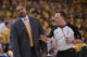 May 10, 2013; Oakland, CA, USA; Golden State Warriors head coach Mark Jackson (left) reacts while talking to NBA referee Bill Spooner (22, right) during the first quarter in game three of the second round of the 2013 NBA Playoffs against the San Antonio Spurs at Oracle Arena. The Spurs defeated the Warriors 102-92. Mandatory Credit: Kyle Terada-USA TODAY Sports