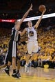 May 10, 2013; Oakland, CA, USA; Golden State Warriors shooting guard Klay Thompson (11) shoots the ball against San Antonio Spurs power forward Tim Duncan (21) during the fourth quarter in game three of the second round of the 2013 NBA Playoffs at Oracle Arena. The Spurs defeated the Warriors 102-92. Mandatory Credit: Kyle Terada-USA TODAY Sports