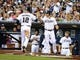 June 25, 2013; San Diego, CA, USA; San Diego Padres catcher Yasmani Grandal (12) is congratulated by second baseman Logan Forsythe (11) after scoring during the second inning against the Philadelphia Phillies at Petco Park.  Mandatory Credit: Christopher Hanewinckel-USA TODAY Sports