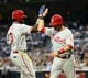 June 25, 2013; San Diego, CA, USA; Philadelphia Phillies left fielder Domonic Brown (9) is congratulated by tthird baseman Michael Young (10) following a three-run home run during the third inning against the San Diego Padres at Petco Park. Mandatory Credit: Christopher Hanewinckel-USA TODAY Sports