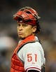 June 25, 2013; San Diego, CA, USA; Philadelphia Phillies catcher Carlos Ruiz (51) looks into the dugout for a sign during the sixth inning against the San Diego Padres at Petco Park. Mandatory Credit: Christopher Hanewinckel-USA TODAY Sports