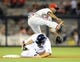June 25, 2013; San Diego, CA, USA; Philadelphia Phillies shortstop Jimmy Rollins (11) makes an out at second base ahead of the slide by San Diego Padres left fielder Carlos Quentin (18) during the sixth inning at Petco Park. Mandatory Credit: Christopher Hanewinckel-USA TODAY Sports