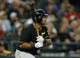 Jun 25, 2013; Seattle, WA, USA; Pittsburgh Pirates third baseman Pedro Alvarez (24) doubles against the Seattle Mariners during the ninth inning at Safeco Field. Mandatory Credit: Joe Nicholson-USA TODAY Sports