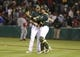 Jun 25, 2013; Oakland, CA, USA; Oakland Athletics relief pitcher Dan Otero (61) celebrates with catcher Stephen Vogt (21) after the win against the Cincinnati Reds at O.co Coliseum. The Oakland Athletics defeated the Cincinnati Reds 7-3. Mandatory Credit: Kelley L Cox-USA TODAY Sports