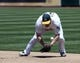 Jun 26, 2013; Oakland, CA, USA; Oakland Athletics first baseman Brandon Moss (37) bobbles the ball during the sixth inning of the game against the Cincinnati Reds at O.Co Coliseum. Mandatory Credit: Ed Szczepanski-USA TODAY Sports