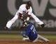 Jun 27, 2013; Boston, MA, USA;  Boston Red Sox second baseman Dustin Pedroia leaps over Toronto Blue Jays player Jose Bautista after throwing down to first to complete a double play during the fourth inning at Fenway Park. Mandatory Credit: Winslow Townson-USA TODAY Sports
