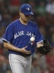 Jun 27, 2013; Boston, MA, USA;  Toronto Blue Jays starting pitcher Chien-Ming Wang tosses the ball after giving up a run during the Boston Red Sox seven run second inning at Fenway Park. Mandatory Credit: Winslow Townson-USA TODAY Sports