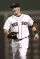 Jun 27, 2013; Boston, MA, USA;  Boston Red Sox left fielder Daniel Nava smiles at a teammate after making a running catch to end the eighth inning during Boston's 7-4 win over the Toronto Blue Jays at Fenway Park. Mandatory Credit: Winslow Townson-USA TODAY Sports