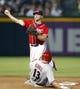 Jun 28, 2013; Atlanta, GA, USA; Atlanta Braves second baseman Dan Uggla (26) turns a double play against the Arizona Diamondbacks in the seventh inning at Turner Field. Mandatory Credit: Brett Davis-USA TODAY Sports