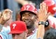 Jun 28, 2013; Los Angeles, CA, USA;  Philadelphia Phillies left fielder Domonic Brown (9) in the dugout after scoring a run in the first inning of the game against the Los Angeles Dodgers at Dodger Stadium. Mandatory Credit: Jayne Kamin-Oncea-USA TODAY Sports