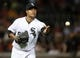 Jun 28, 2013; Chicago, IL, USA; Chicago White Sox starting pitcher Jose Quintana (62) tosses the ball to first base during the fifth inning in the second game of a baseball doubleheader against the Cleveland Indians at US Cellular Field. Mandatory Credit: Jerry Lai-USA TODAY Sports