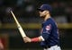 Jun 28, 2013; Chicago, IL, USA; Cleveland Indians first baseman Nick Swisher (33) holds a piece of a broken bat during the sixth inning in the second game of a baseball doubleheader against the Chicago White Sox at US Cellular Field. Mandatory Credit: Jerry Lai-USA TODAY Sports