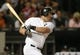Jun 28, 2013; Chicago, IL, USA; Chicago White Sox designated hitter Adam Dunn (32) hits a two-run single against the Cleveland Indians during the sixth inning in the second game of a baseball doubleheader at US Cellular Field. Mandatory Credit: Jerry Lai-USA TODAY Sports