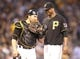 Jun 29, 2013; Pittsburgh, PA, USA; Pittsburgh Pirates catcher Russell Martin (left) and starting pitcher Francisco Liriano (47) talk on the mound against the Milwaukee Brewers during the sixth inning at PNC Park. The Pittsburgh Pirates won 2-1. Mandatory Credit: Charles LeClaire-USA TODAY Sports