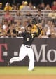 Jun 29, 2013; Pittsburgh, PA, USA; Pittsburgh Pirates left fielder Starling Marte (6) makes a catch in the outfield against the Milwaukee Brewers during the seventh inning. The Pittsburgh Pirates won 2-1 at PNC Park. Mandatory Credit: Charles LeClaire-USA TODAY Sports