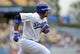 June 30, 2013; Los Angeles, CA, USA; Los Angeles Dodgers first baseman Adrian Gonzalez (23) runs after hitting an RBI double during the fifth inning against the Philadelphia Phillies at Dodger Stadium. Mandatory Credit: Gary A. Vasquez-USA TODAY Sports