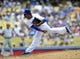 June 30, 2013; Los Angeles, CA, USA; Los Angeles Dodgers relief pitcher Jose Dominguez (60) pitches during the eighth inning against the Philadelphia Phillies at Dodger Stadium. Mandatory Credit: Gary A. Vasquez-USA TODAY Sports