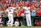Jul 1, 2013; Washington, DC, USA; Washington Nationals shortstop Ian Desmond (20) high fives third baseman Ryan Zimmerman (11) after scoring a run in the third inning against the Milwaukee Brewers at Nationals Park. Mandatory Credit: Evan Habeeb-USA TODAY Sports