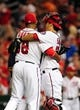 Jul 1, 2013; Washington, DC, USA; Washington Nationals catcher Kurt Suzuki (24) celebrates with pitcher Fernando Abad (58) after beating the Milwaukee Brewers 10-5 at Nationals Park. Mandatory Credit: Evan Habeeb-USA TODAY Sports