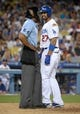 Jun 29, 2013; Los Angeles, CA, USA; Los Angeles Dodgers center fielder Matt Kemp (27) argues with home plate umpire C.B. Bucknor (54) after striking out against the Philadelphia Phillies at Dodger Stadium. The Dodgers defeated the Phillies 4-3. Mandatory Credit: Kirby Lee-USA TODAY Sports
