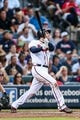 Jul 2, 2013; Atlanta, GA, USA; Atlanta Braves first baseman Freddie Freeman (5) hits an RBI double in the fourth inning against the Miami Marlins at Turner Field. Mandatory Credit: Daniel Shirey-USA TODAY Sports