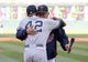 Jul 2, 2013; Minneapolis, MN, USA; Minnesota Twins manager Ron Gardenhire hugs New York Yankees relief pitcher Mariano Rivera (42) during the presentation of his rocking chair before the game at Target Field. Mandatory Credit: Jesse Johnson-USA TODAY Sports
