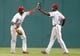 Jul 2, 2013; Pittsburgh, PA, USA; Philadelphia Phillies left fielder Domonic Brown (left) and right fielder John Mayberry Jr. (15) celebrate after defeating the Pittsburgh Pirates at PNC Park. The Philadelphia Phillies won 3-1. Mandatory Credit: Charles LeClaire-USA TODAY Sports