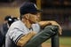 Jul 2, 2013; Minneapolis, MN, USA; New York Yankees manager Joe Girardi looks from the dug out during the eighth inning against the Minnesota Twins at Target Field. The Yankees won 7-3. Mandatory Credit: Jesse Johnson-USA TODAY Sports
