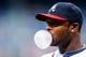 Jul 3, 2013; Atlanta, GA, USA; Atlanta Braves left fielder Justin Upton (8) blows a bubble before the game against the Miami Marlins at Turner Field. Mandatory Credit: Daniel Shirey-USA TODAY Sports