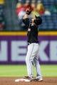 Jul 3, 2013; Atlanta, GA, USA; Miami Marlins second baseman Donovan Solano (17) celebrates after a double in the fifth inning against the Atlanta Braves at Turner Field. Mandatory Credit: Daniel Shirey-USA TODAY Sports