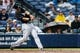 Jul 3, 2013; Atlanta, GA, USA; Miami Marlins center fielder Justin Ruggiano (20) hits a three-run home run in the fifth inning against the Atlanta Braves at Turner Field. Mandatory Credit: Daniel Shirey-USA TODAY Sports