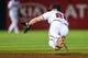 Jul 3, 2013; Atlanta, GA, USA; Atlanta Braves second baseman Dan Uggla (26) makes a diving stop in the eighth inning against the Miami Marlins at Turner Field. Mandatory Credit: Daniel Shirey-USA TODAY Sports
