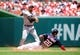 Jul 4, 2013; Washington, DC, USA; Washington Nationals shortstop Ian Desmond (20) slides in to second base while Milwaukee Brewers second baseman Jeff Bianchi (14) turns a double play at Nationals Park. Mandatory Credit: Evan Habeeb-USA TODAY Sports