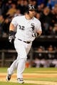 Jul 2, 2013; Chicago, IL, USA; Chicago White Sox first baseman Adam Dunn (32) hits an 2-Run home run during the seventh inning against the Baltimore Orioles at U.S. Cellular Field. Mandatory Credit: Reid Compton-USA TODAY Sports