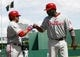 Jul 4, 2013; Pittsburgh, PA, USA; Philadelphia Phillies catcher Carlos Ruiz (left) greets first baseman Ryan Howard (6) at home after Howard scored a run against the Pittsburgh Pirates during the sixth inning at PNC Park. The Philadelphia Phillies won 6-4. Mandatory Credit: Charles LeClaire-USA TODAY Sports