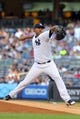Jul 5, 2013; Bronx, NY, USA; New York Yankees starting pitcher Ivan Nova (47) pitches against the Baltimore Orioles during the first inning of a game at Yankee Stadium. Mandatory Credit: Brad Penner-USA TODAY Sports