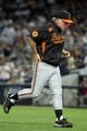 Jul 5, 2013; Bronx, NY, USA; Baltimore Orioles manager Buck Showalter (26) leaves the mound after a conference with his pitcher during the ninth inning of a game against the New York Yankees at Yankee Stadium. Mandatory Credit: Brad Penner-USA TODAY Sports