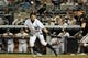 Jul 5, 2013; Bronx, NY, USA; New York Yankees right fielder Ichiro Suzuki (31) drops down a sacrifice bunt as Baltimore Orioles catcher Matt Wieters (32) fields the ball during the ninth inning of a game at Yankee Stadium. Mandatory Credit: Brad Penner-USA TODAY Sports