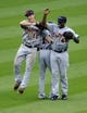 Jul 6, 2013; Cleveland, OH, USA; Detroit Tigers left fielder Andy Dirks (12) right fielder Torii Hunter (48) and center fielder Austin Jackson (14) celebrate a 9-4 over the Cleveland Indians at Progressive Field. Mandatory Credit: David Richard-USA TODAY Sports