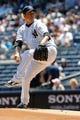 Jul 7, 2013; Bronx, NY, USA;  New York Yankees starting pitcher Hiroki Kuroda (18) pitches during the first inning against the Baltimore Orioles at Yankee Stadium. Mandatory Credit: Anthony Gruppuso-USA TODAY Sports